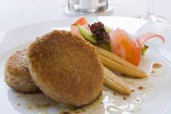 Gegrilltes Kotelett und gemischtes Gemüse Stockbild