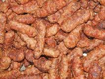 Gegrilltes rumänisches traditionelles Lebensmittel der Fleischrouladen (Mici oder Mititei) Stockbild
