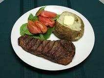 Gegrilltes Steakabendessen Stockbilder