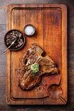 Gegrilltes T-Bone-Steak und Kräuterbutter Lizenzfreie Stockfotografie