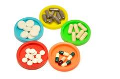 Gegroepeerde pillen Stock Foto