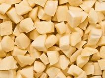 Gehackter ungekochter roher Knoblauchlebensmittelhintergrund Stockfoto