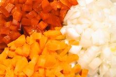 Gehakte groene paprika, wortel en ui Royalty-vrije Stock Afbeelding