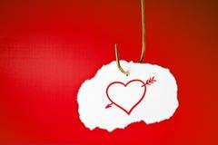 Gehaktes Herz mit Pfeil-Konzept Lizenzfreie Stockfotos