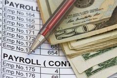Gehaltsabrechnungsausgaben oder -einnahmen lizenzfreie stockfotos