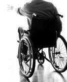 Gehandicapte bejaarden in een rolstoel in de ruimte Royalty-vrije Stock Afbeelding