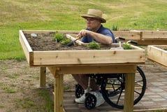 Gehandicapte tuinman Stock Foto