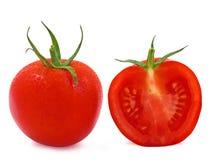 Geheel en een halve tomaat met waterdalingen Royalty-vrije Stock Afbeelding