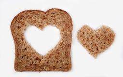 Geheel tarwebrood met hart Stock Foto