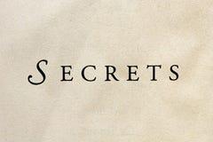 ?Geheimnisse? auf dem strukturierten Papier - horizontal Stockbild