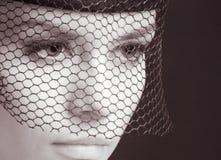 Geheimnisvolle Frau Stockbild
