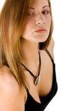 Geheimnisvolle junge Frau mit einem Anhänger Stockbilder
