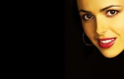 Geheimnisvolles Frauenlächeln Stockfotos