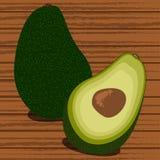 Gehele en gesneden avocado op bruine achtergrond Royalty-vrije Stock Foto's