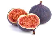 Gehele en gesneden fig. Stock Foto's