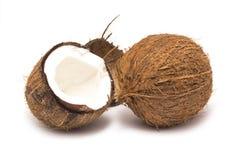 Gehele kokosnoot en de helft Stock Fotografie