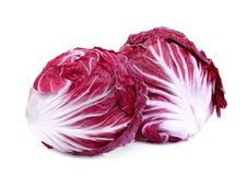 Gehele rode radicchio twee of rode die salade op wit wordt geïsoleerd stock fotografie