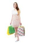 Gehen mit Einkaufstasche Lizenzfreie Stockfotos