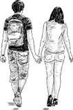 Gehende junge Paare Stockfotos