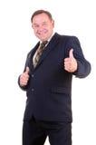 Gehender Daumen des Geschäftsmannes oben lizenzfreies stockfoto