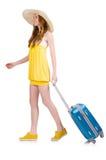 Gehendes junges Mädchen mit dem Reisekasten lokalisiert Stockfotografie