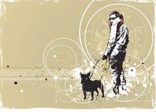 Gehendes Mädchen mit ihrem Hund Stockfotos