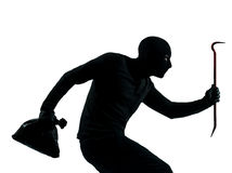 Gehendes ruhiges Schattenbild des Diebverbrechers Stockfoto