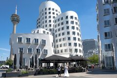 Free Gehry Buildings And Rhine Tower, Medienhafen, Media Harbor, Media Harbour, Dusseldorf With Few People During Covid19 Panemic Royalty Free Stock Photo - 192154025
