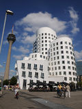 Gehry houses in Duesseldorf under Rheitower. The Gehry buildings are considered Düsseldorf's new landmark Royalty Free Stock Images
