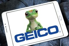 GEICO Insurance Company logo. Logo of GEICO Insurance Company on samsung tablet. GEICO, Government Employees Insurance Company, is an American auto insurance Royalty Free Stock Photo