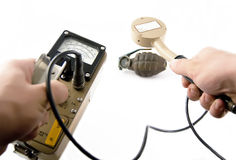 Geiger Counter. /surveyor with probe measuring radiation of vintage grenade Stock Photography