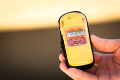Geiger counter in hand Royalty Free Stock Photos