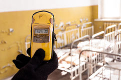 Geiger Counter in hand Stock Photos