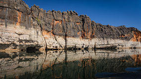Geikie Gorge, Fitzroy Crossing, Western Australia. Devonian sandstone cliffs of Geikie Gorge reflected in a quiet river pool of the Fitzroy River royalty free stock photography