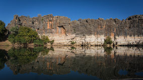Geikie Gorge, Fitzroy Crossing, Western Australia. Sandstone Cliffs reflected in a pool of the Fitzroy River, Sunrise on the Beehives - Bungle Bungles, Kimberley Stock Images