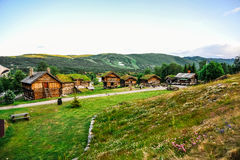 GEILO, NORWAY: Old traditional framehouses with grass on the roof in the middle of valley, Geilo, Norway Royalty Free Stock Photography