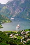 Geiranger fjord. The geiranger fjord in Norway with two cruise ships leaving Stock Image