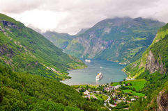 Geiranger fjord. The geiranger fjord in Norway with two cruise ships leaving. On the UNESCO list of world herritage Stock Photo