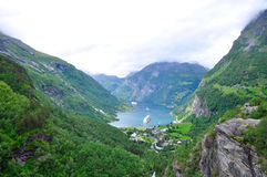 Geiranger fjord. The geiranger fjord in Norway with two cruise ships leaving. On the UNESCO list of world herritage Stock Photos