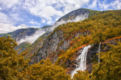 Geiranger fjord. magnificent waterfall at sunset in Norway Royalty Free Stock Photo