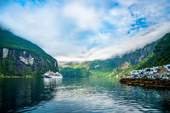 Geiranger fjord, Norway. Geiranger fjord, Beautiful Nature Norway. It is a 15-kilometre 9.3 mi long branch off of the Sunnylvsfjorden, which is a branch off of Stock Photos