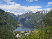 Geiranger fjord, Norway with cruise ship, mountains and village Stock Photos