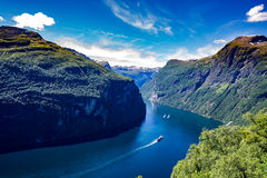 Geiranger fjord, Norway. Geiranger fjord, waterfall Seven Sisters. It is a 15-kilometre 9.3 mi long branch off of the Sunnylvsfjorden, which is a branch off of Stock Photos