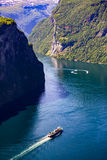 Geiranger fjord, Norway. Geiranger fjord, waterfall Seven Sisters. It is a 15-kilometre 9.3 mi long branch off of the Sunnylvsfjorden, which is a branch off of Royalty Free Stock Photos