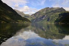 Geiranger fjord. Reflections in the water of the fiord stock photos