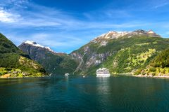 View of Cruiseships and Majestic Mountains at Geiranger Fjord in Summer royalty free stock photos