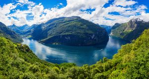 Geiranger at Geirangerfjord, Norway. Geirangerfjord aerial panoramic view from Ornesvingen eagle road viewpoint, located near the Geiranger village, Norway Royalty Free Stock Photography