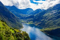Geiranger at Geirangerfjord, Norway. Geirangerfjord aerial panoramic view from Ornesvingen eagle road viewpoint, located near the Geiranger village, Norway Stock Images