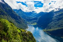 Geiranger at Geirangerfjord, Norway. Geirangerfjord aerial panoramic view from Ornesvingen eagle road viewpoint, located near the Geiranger village, Norway Royalty Free Stock Photo