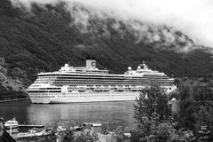 Geiranger, Norway - January 25, 2010: cruise ship in norwegian fjord. Travel destination, tourism. Adventure, discovery. Geiranger, Norway - January 25, 2010 stock photography